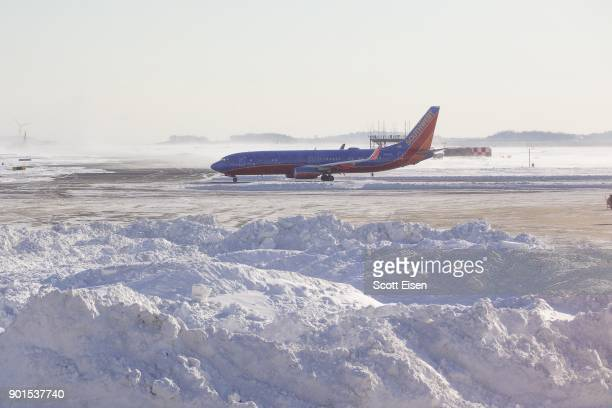 Southwest Airlines airplane navigates a snowy and icy Logan International Airport following a 'bomb cyclone' the previous day on January 5 2018 in...