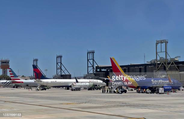 Southwest airlines and Delta sirlines aircrafts are seen at the San Jose del Cabo International Airport in Baja California state, Mexico, on April...