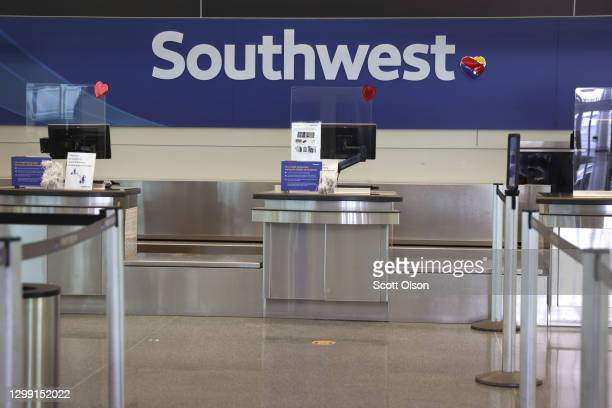 Southwest Airlines baggage check position sits empty at Midway International Airport on January 28, 2021 in Chicago, Illinois. Southwest Airlines...