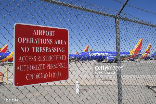 Southwest Airlines Boeing 737 MAX aircraft are parked on the tarmac after being grounded at the Southern California Logistics Airport in Victorville...