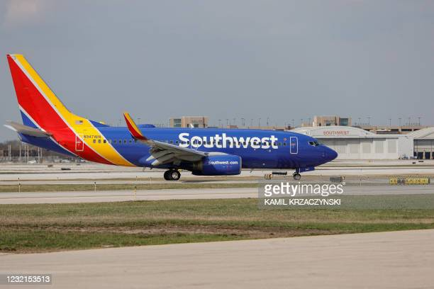 Southwest Airlines Boeing 737-700 jet taxis to the gate after landing at Midway International Airport in Chicago, Illinois, on April 6, 2021.