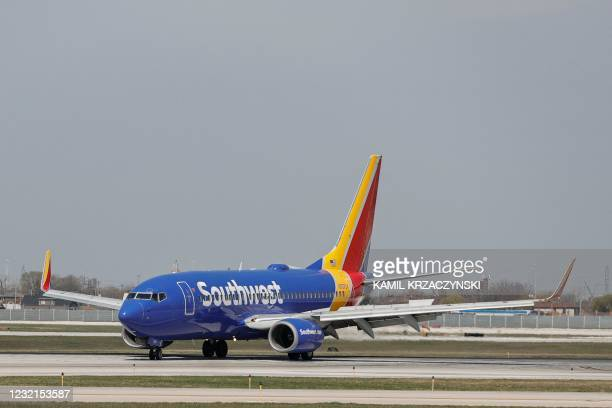 Southwest Airlines Boeing 737-7H4 jet taxis to the gate after landing at Midway International Airport in Chicago, Illinois, on April 6, 2021.