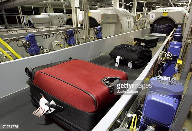 Southwest Airlines checked luggage enters an explosive detection system at the Oakland International Airport June 22 2006 in Oakland California The...