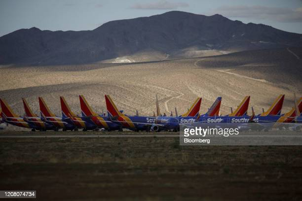 Southwest Airlines Co. Aircraft sit parked at a field in Victorville, California, U.S., on Monday, March 23, 2020. Southwest, which carries the most...