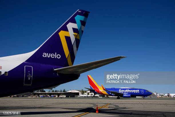 Southwest Airlines Co. Boeing 737 taxis past an Avelo Airlines aircraft at Hollywood Burbank Airport on April 28, 2021 in Burbank, California. -...
