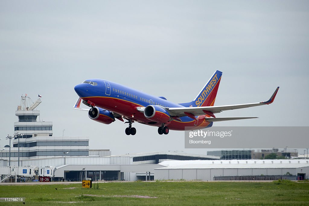 A Southwest Airlines Co  Boeing 737-7H4 plane takes off from Love