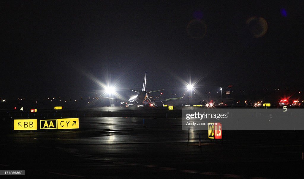 Southwest Airlines Flight 345 remains on runway 4 at LaGuardia Airport in the Queens borough of New York City. The flight, which originated in Nashville, landed at 5:45 p.m. and was carrying 149 passengers and crew. A reported 10 people were injured.
