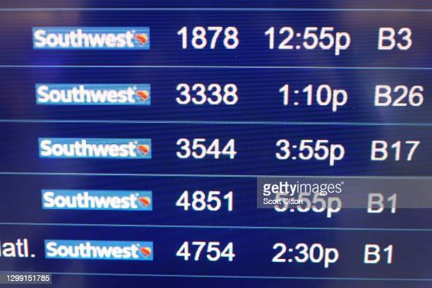 Southwest Airlines flights departing from Midway International Airport are posted on a board at the airport on January 28, 2021 in Chicago, Illinois....