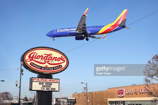 Southwest Airlines jet lands at Midway International Airport on January 28, 2021 in Chicago, Illinois. Southwest Airlines today reported its first...