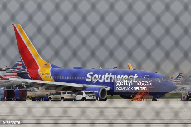 A Southwest Airlines jet sits on the runway at Philadelphia International Airport after it was forced to land with an engine failure in Philadelphia...
