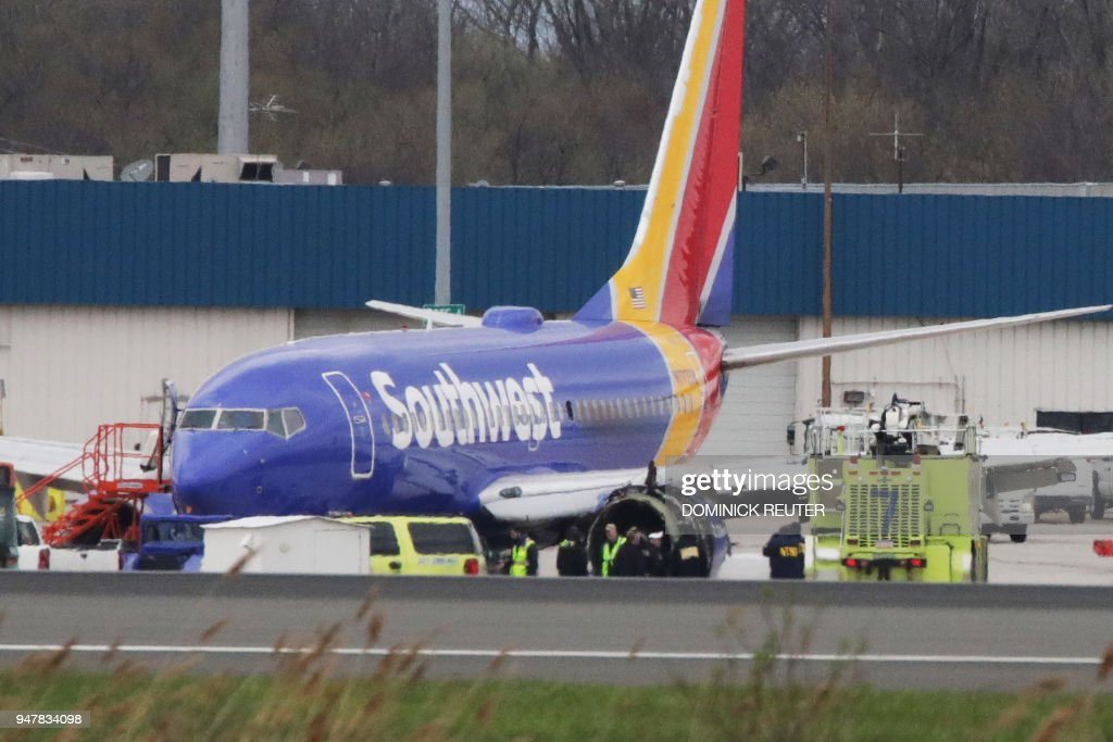 A Southwest Airlines jet sits on the runway at Philadelphia International Airport after it was forced to land with an engine failure, in Philadelphia, Pennsylvania, on April 17, 2018. A catastrophic engine failure on a Southwest Airlines flight from New York to Dallas killed one person and forced an emergency landing in Philadelphia on Tuesday in a terrifying ordeal for passengers. /