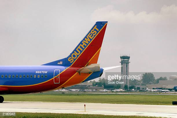 Southwest Airlines jet taxis to the gate July 21 2003 at Midway Airport in Chicago Illinois Southwest reported a net income of $246 million more than...