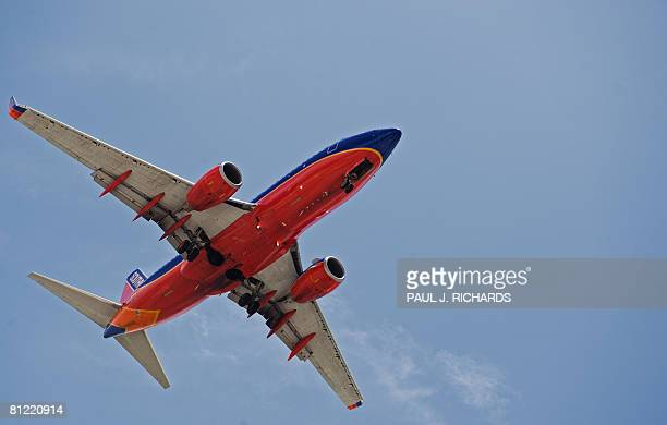 A Southwest Airlines passenger jet makes its final approach to Tampa International Airport May 23 in Tampa Florida AFP Photo/Paul J Richards