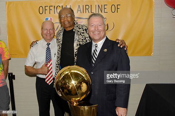 Southwest Airlines pilot joins NBA legend Sam Jones and Orlando Mayor Buddy Dyer with the Larry O'Brien Trophy at Orlando International Airport on...