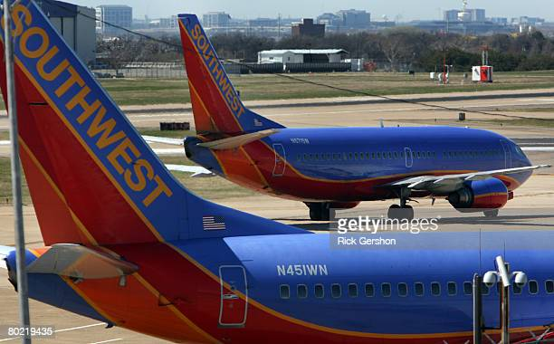 Southwest Airlines planes taxi on the runway at airline's hub at Dallas Love Field March 12 in Dallas Texas Southwest Airlines said it has grounded...