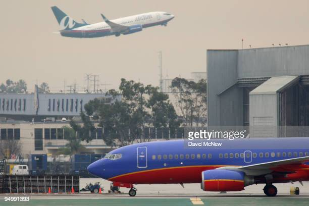 Southwest airplane taxies at Los Angeles International Airport after a snow storm on the East Coast caused the cancellation of numerous flights out...