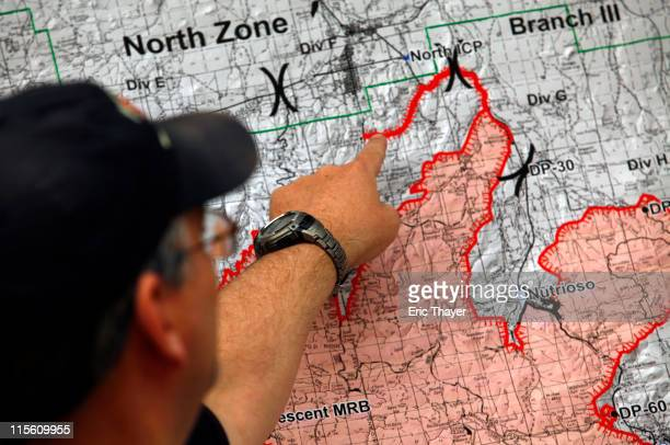 Southwest Area Fire Management public information officer Jim Whittington points to a fire map during a news conference June 8 2011 in Springerville...