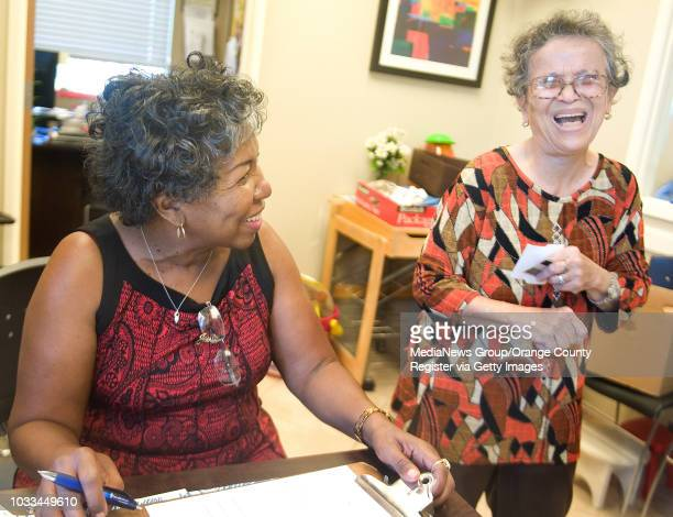 Southwest Community volunteer Dolores EalyO'Neal chats with Nelia Villafranco who gets food assistence EalyO'Neal has helped for about 8 years...
