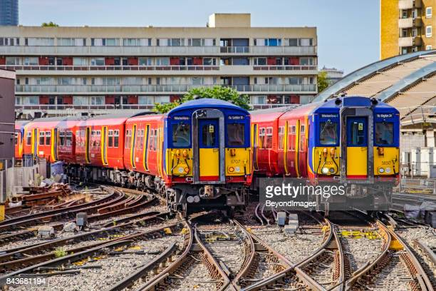 southwest commuter trains coming and going from waterloo station, london - waterloo railway station london stock pictures, royalty-free photos & images