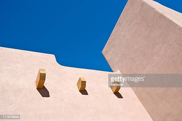 Southwest Santa Fe Adobe Stucco Building with Wooden Roof Beams