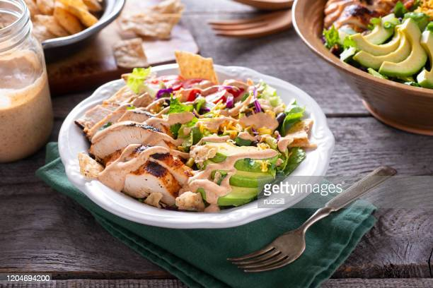 southwestern chicken chopped salad - salad dressing stock pictures, royalty-free photos & images