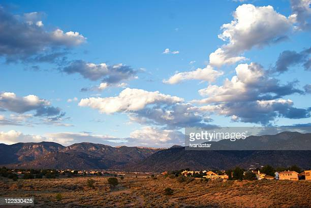 southwestern landscape with sandia mountains - sandia mountains stock photos and pictures