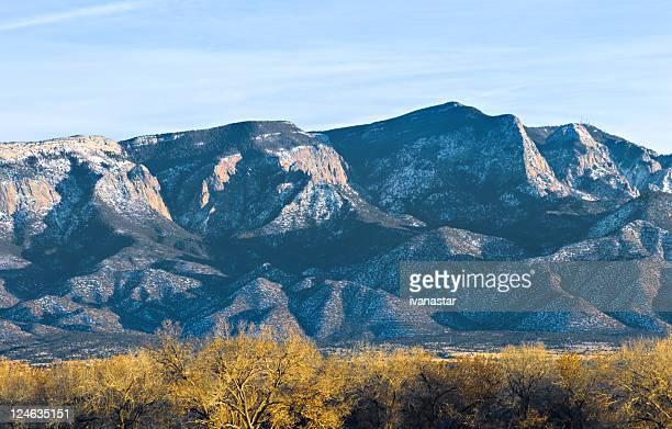 southwestern landscape with sandia mountains - sandia mountains stock pictures, royalty-free photos & images