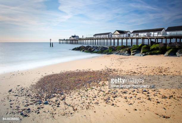 southwold pier and beach landscape - suffolk england stock photos and pictures