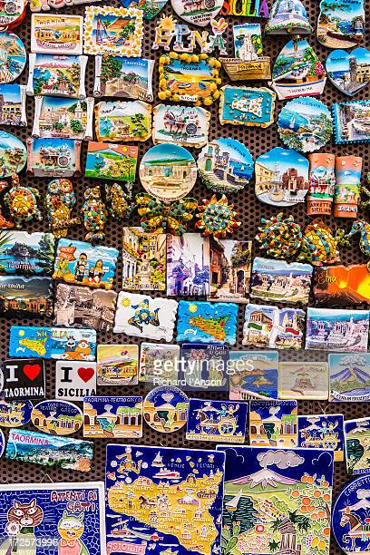 souveniers displayed outside shop - taormina stock pictures, royalty-free photos & images