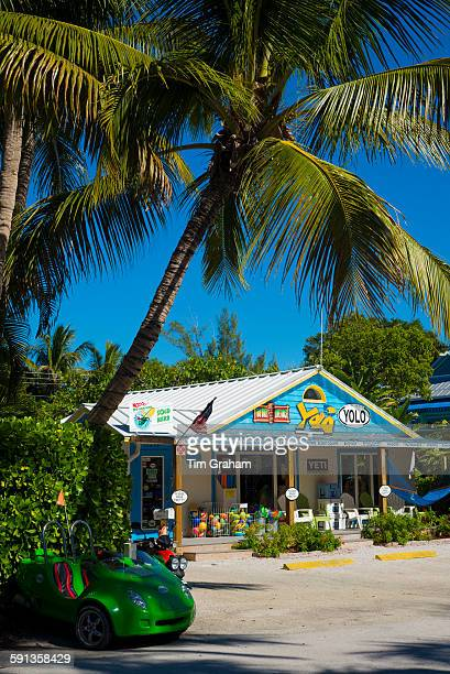 Souvenir and watersports equipment shop Yolo and palm trees in downtown Captiva Island in Florida USA