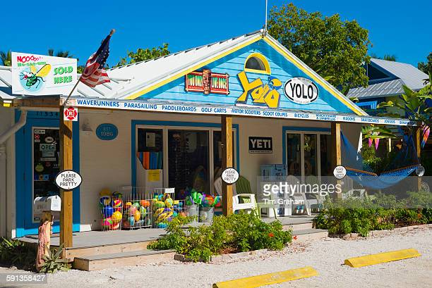 Souvenir and watersports equipment shop Yolo with adirondack chairs and hammock in downtown Captiva Island in Florida USA