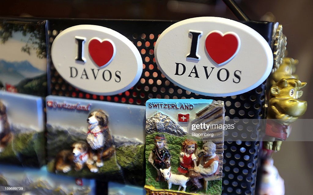 Souvenir badges with the phrase 'I Love Davos' sit displayed for sale inside a tourist store in Davos, Switzerland, on Friday, Jan. 18, 2013. Next week the business elite gather in the Swiss Alps for the 43rd annual meeting of the World Economic Forum in Davos, the five day event runs from Jan. 23-27. Photographer: Chris Ratcliffe/Bloomberg via Getty Images