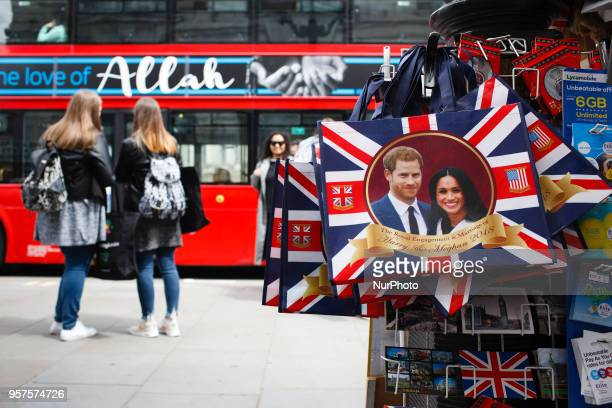 Souvenir bags hang on display in Piccadilly Circus ahead of the muchanticipated wedding of Britain's Prince Harry to former US actress Meghan Markle...