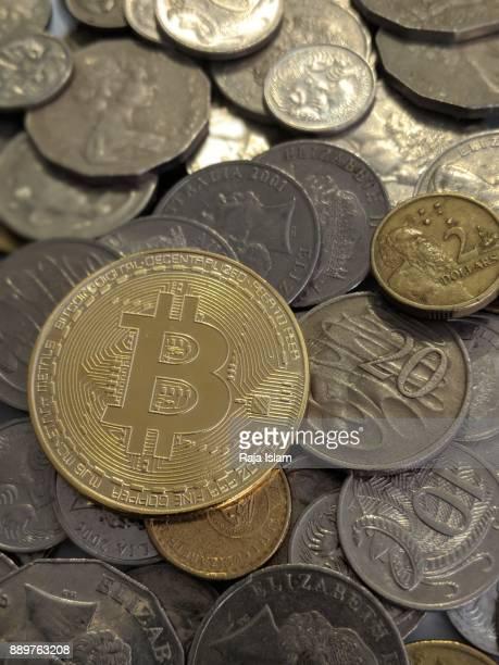 Souvenir bitcoin with other coins.