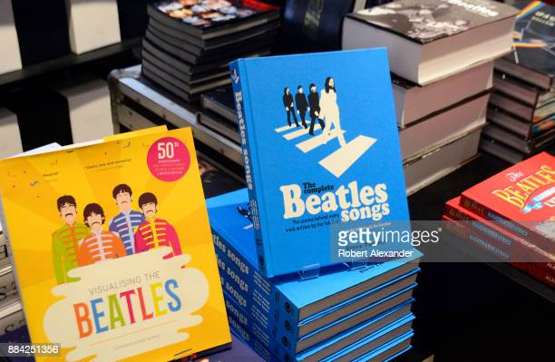 Souvenir books are among the Beatlesrelated items for sale at Abbey Road Shop located near Abbey Road Studios in London England formerly known as EMI...