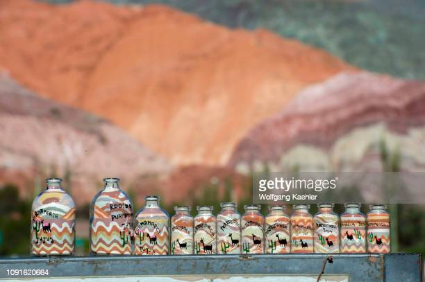 Souvenir bottles with colorful sand from the rock formations of Cerro de los Siete Colores, in the Andes Mountains in Purmamarca, Jujuy Province,...