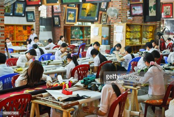 Souvenir factory near Hanoi. Vietnam is today a major economic reality manufacturing and touristic, where large cities offer a wonderful mix of...