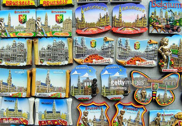 Souvenir fridge magnets bearing Brussels city landmarks and coatofarms are seen for sale outside a tourist store on the Grand Place in Brussels...