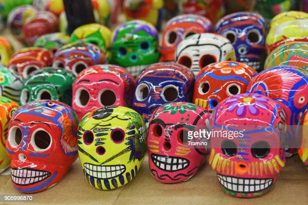 souvenir from mexico - painted colorful skulls - sugar skull stock photos and pictures