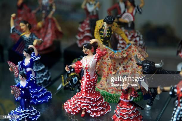 Souvenir gift model figures in shop window display Benidorm Spain flamenco dancers bull fighting matador