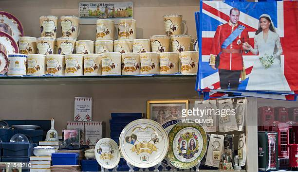 Souvenir gifts celebrating the upcoming birth of the royal baby of Prince William Duke of Cambridge and Catherine the Duchess of the Cambridge are...