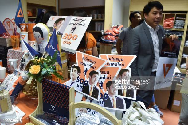 Souvenir items bearing images of Thanathorn Juangroongruangkit leader of the opposition Future Forward party are displayed at the party's...