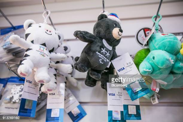 Souvenir keychains featuring 2018 PyeongChang Winter Olympic Games mascots Soohorang left and Paralympic Games mascot Bandabi center are displayed...