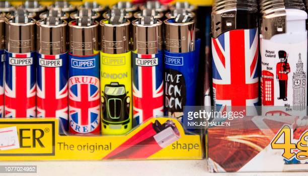 Souvenir lighters depicting landmarks and themes of the United Kingdom are pictured in central London on January 4 2019 British lawmakers will in...
