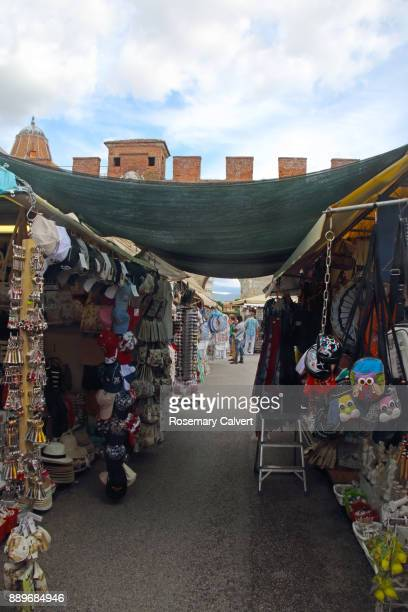 Souvenir market stalls outside Pisa ancient city wall.