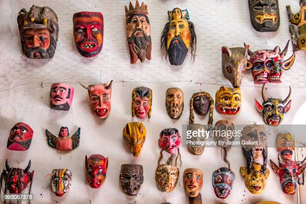 souvenir masks for sale in a shop in san miguel de allende, mexico - craft product stock photos and pictures