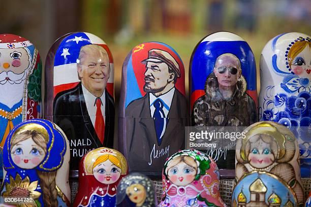 Souvenir matryoshka dolls decorated with Donald Trump US Presidentelect left Vladimir Lenin former Communist Party founder center and Vladimir Putin...