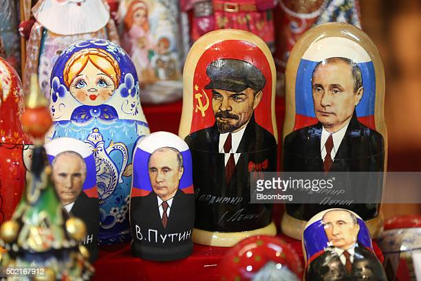 Souvenir matryoshka dolls featuring Vladimir Lenin former Communist Party founder center and Vladimir Putin Russia's president right sit for sale at...