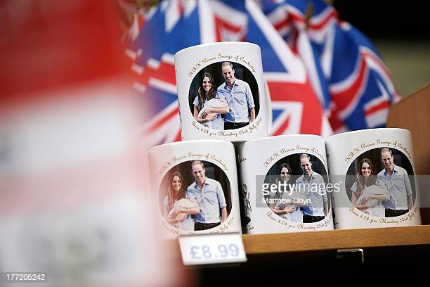 Souvenir mugs celebrating the birth of Prince George of Cambridge are sold in a shop near Piccadilly Circus on August 22 2013 in London England