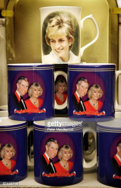Souvenir mugs celebrating the marriage of Prince Charles and Camilla ParkerBowles with a mug of the late Princess of Wales are displayed on March 18...